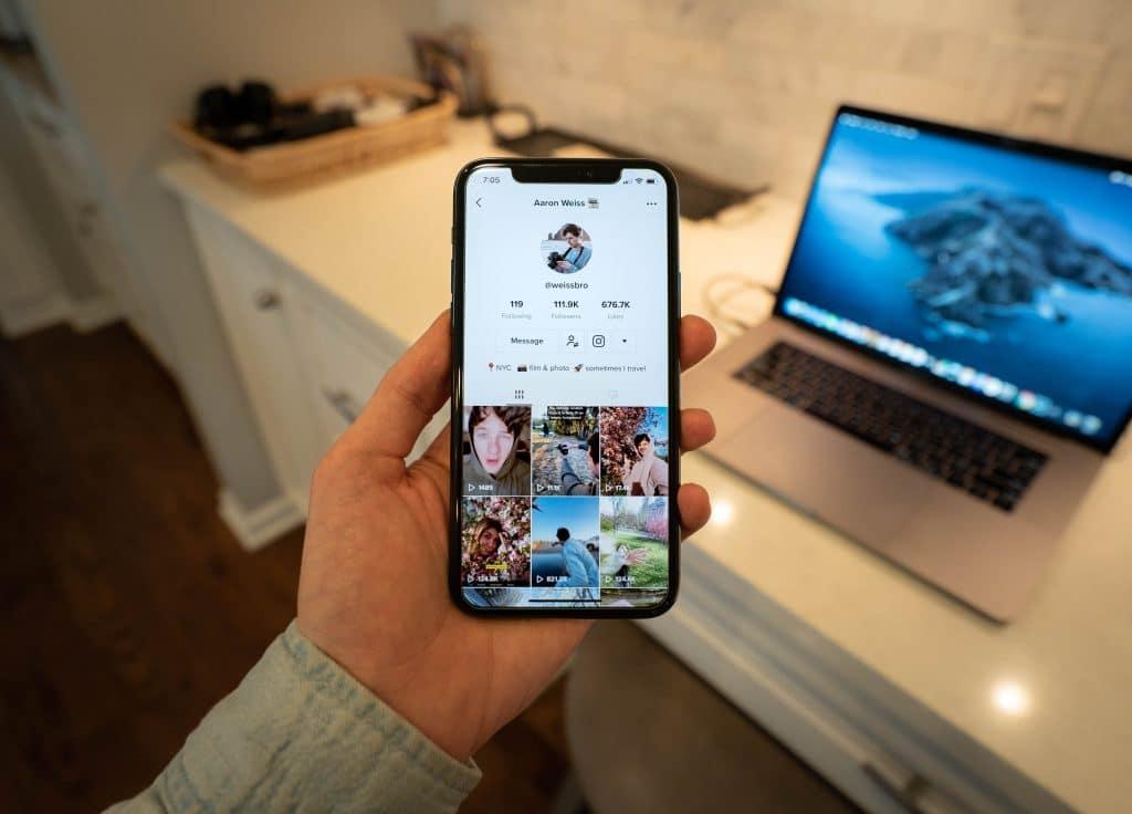 tiktok person holding white samsung galaxy smartphone